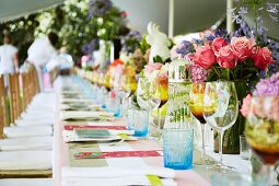 Long dining table in garden set for birthday party