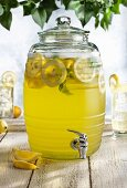 Fresh lemonade in a jar with a tap