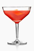A red cocktail garnished with orange zest