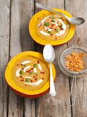 Cream of pumpkin soup with red lentils, chilli and mint