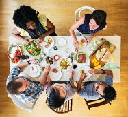 Friends eating together at a dinner party