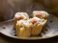 Siu Mai Dim Sum (Cantonese pork and prawn dumplings) in a steamer
