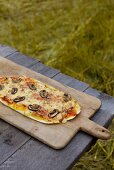 Grilled Italian pizza with salsiccia