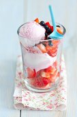 Strawberry ice cream with strawberries and blueberries