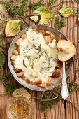 Gratinated porcini mushrooms with mozzarella and rosemary