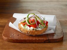 Bagel with cream cheese, wild salmon, capers and cucumber