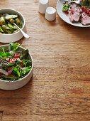 Salad, dill potatoes and roast lamb (Scandinavia)