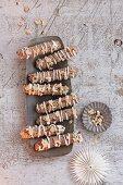 Meringue sticks with chopped hazelnuts
