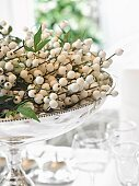 White artificial berries in silver dish