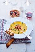 Pumpkin soup with raw ham