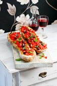 Baguette bruschetta with tomatoes and olives
