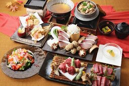Party platters with beef, salads and sashimi (Japan)