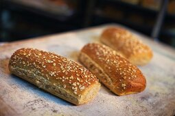 Three seeded rolls in a bakery