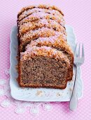 Banana bread with pink honey and coconut shavings