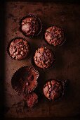 Dark chocolate muffins and one empty paper case