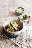 Five-spice duck breast with asian mushroom drunken noodles