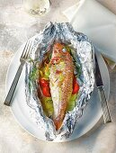 Red mullet with vegetables in aluminium foil