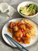 Sweet and sour chicken with fried rice served with bok choy
