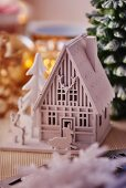 White wooden house and deer Christmas ornaments (close-up)