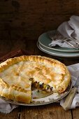 Courgette, pepper and feta cheese puff pastry pie, sliced