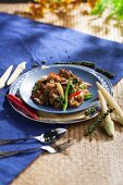 Fried rice noodles with beef, basil, peppercorns and chilli (Thailand)