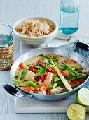 Thai curry with chicken, mange tout and chillis