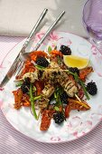 A salad of dried tomatoes, Thai asparagus and blackberries with pork skewers
