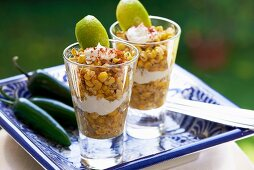 Esquites (Mexican corn salad with epazote, savory, chilli peppers, mayonnaise and chilli powder)