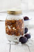 Damson stones preserved in a jar of alcohol for making liqueur or schnapps