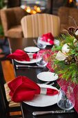 Christmas table with festive arrangement in dining room