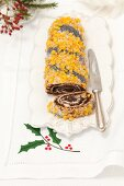 Poppyseed roll with sugar cream and candied orange zest
