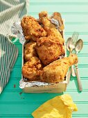 Buttermilk fried chicken in a wooden crate for a picnic