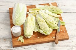 Fresh Chinese cabbage and salt on a chopping board