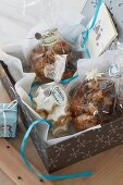 Homemade Christmas biscuits in cellophane bags as gifts