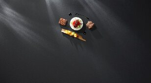 Spiced rice pudding with variations of rhubarb, candied fruits in cinnamon sticks and honey jus (flavour pairing)