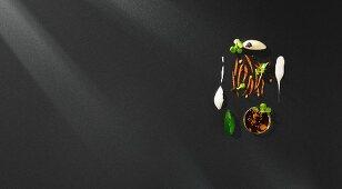 Grated botargo mustard ice cream, lamb's lettuce cream and dashi black tea broth (flavour pairing)