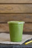 A smoothie made with matcha tea, bananas, spinach, almond butter, coconut milk, cinnamon and pollen