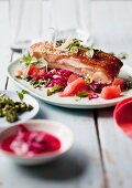 Crispy pork belly on a grapefruit and fennel salad with herb pesto (Asia)