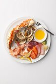 Seafood platter with sauce, wasabi paste and lemon wedges