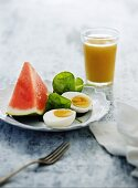 Hard boiled eggs with watermelon and fruit juice