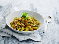 Vegetable stew with pork mince and pasta in a soup bowl