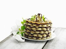 A pancake cake with bananas and nut and nougat cream