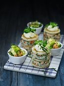 Stacks of shrimp salad sandwiches