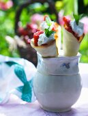 Crepe rolls filled with strawberries and cream