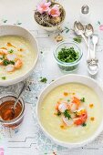 Cream of fennel soup with apple, honey and prawns