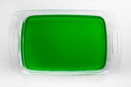 Glass tray of lime gelatin