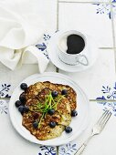 Blueberry pancakes and black coffee (seen from above)