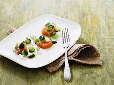 Salmon canapes with cucumber balls and mini mozzarella