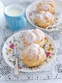 Profiteroles with whipped cream and icing sugar