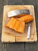 Hot-smoked salmon on a chopping board